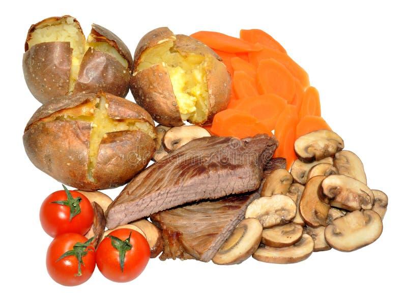 Обедающий стейка говядины и картошки куртки стоковые изображения
