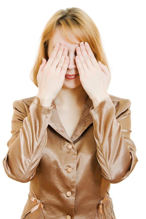 обе руки глаз крышек коммерсантки стоковая фотография
