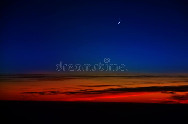 облака над заходом солнца стоковое изображение