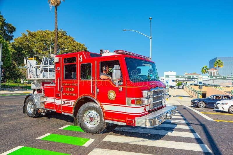 Область Беверли-Хиллз и пожарные машины, спешность, который нужно увольнять стоковое изображение rf