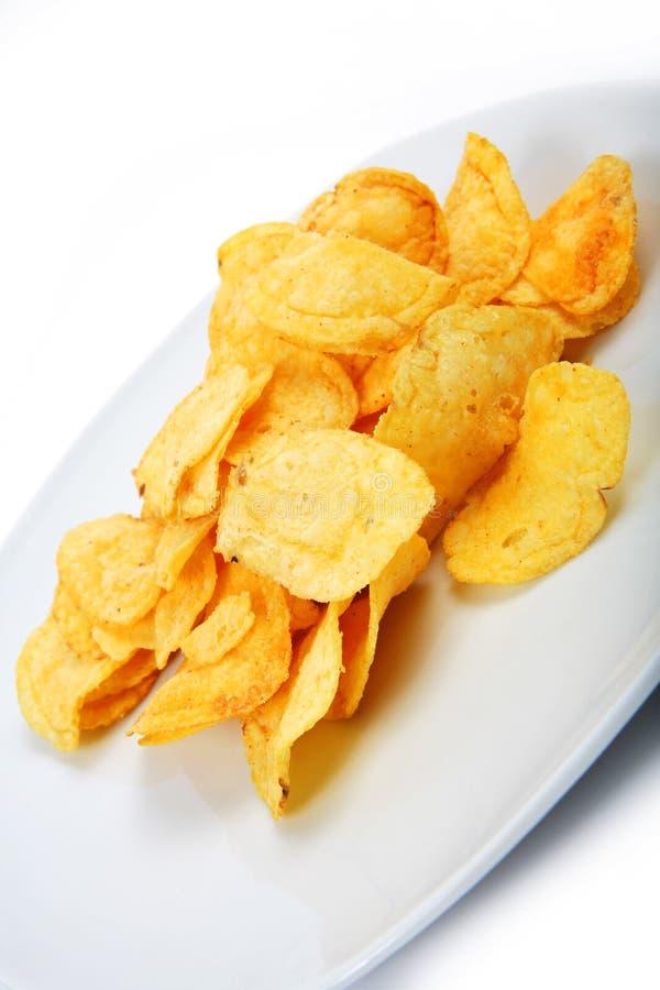 обломоки предпосылки изолировали белизну соли картошки стоковое фото