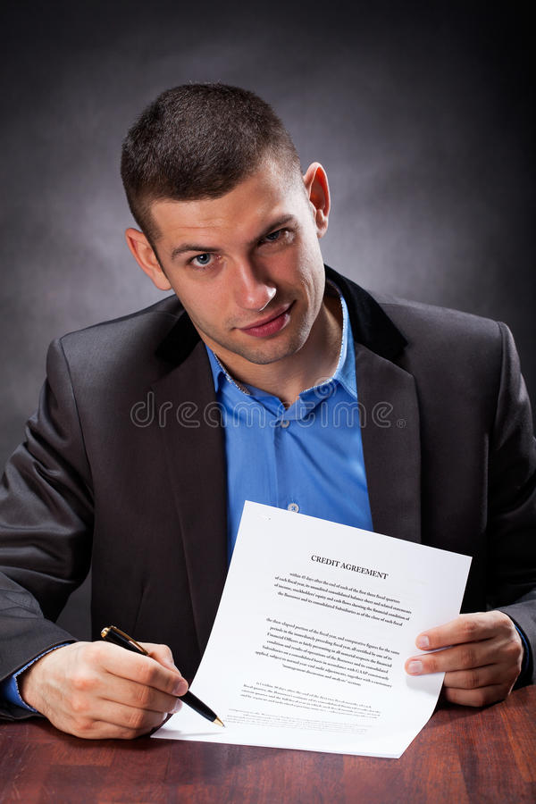 Обманщик держа согласование стоковая фотография rf