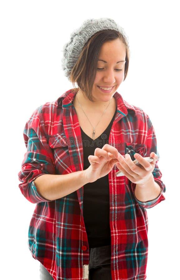 Download Обмен текстовыми сообщениями молодой женщины на мобильном телефоне Стоковое Изображение - изображение насчитывающей технология, удерживание: 41651697