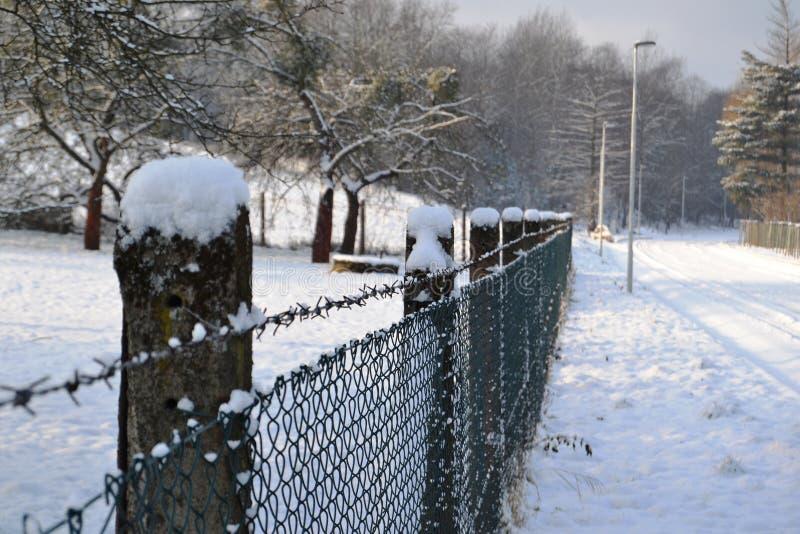 Обнести забором зима стоковое изображение