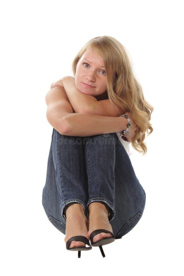 обнимать колени стоковое фото rf