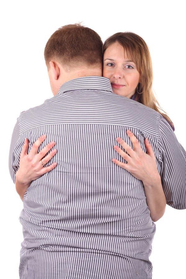 обнимать человека девушки стоковое фото rf
