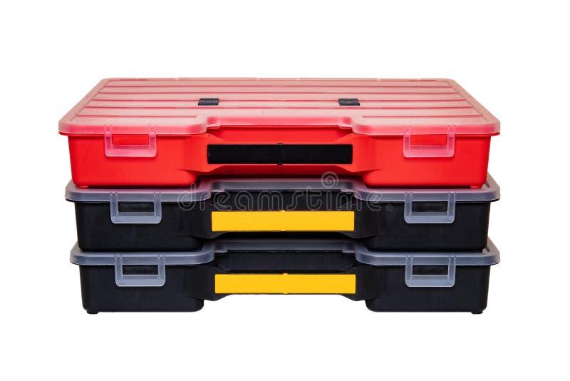 Оборудование мастера 3 профессиональных пластиковых ящика для хранения для изолированных винтов, болтов, шпонок и некоторых други стоковые изображения rf