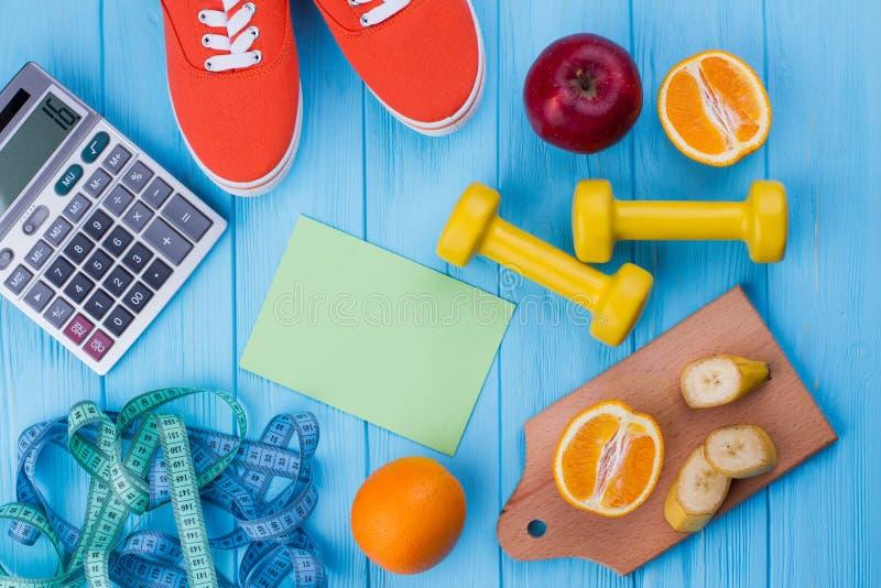 Оборудование фитнеса, плоды, измеряя лента стоковые изображения