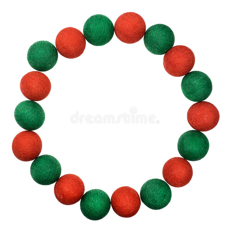Обрамите красный и зеленый шарик рождества изолированный на белой предпосылке стоковое фото rf