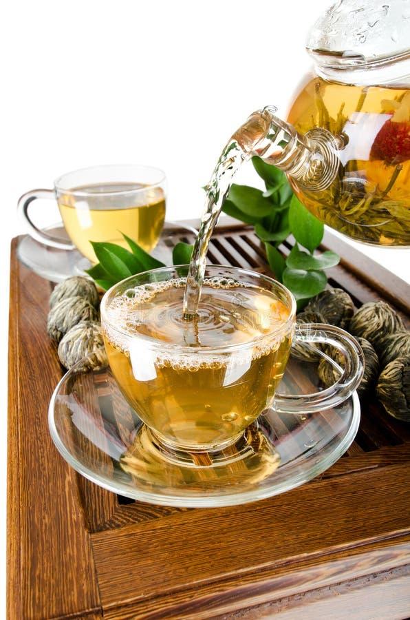 обслуживайте чай стоковое изображение