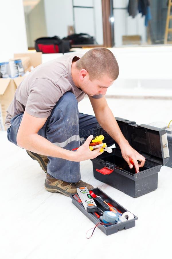 Обслуживайте человека с его Toolbox стоковые фотографии rf