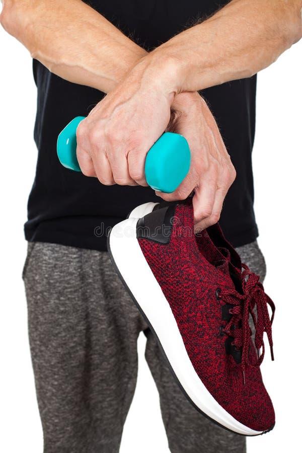 Обувь & гантель ` s человека sporty стоковое фото rf