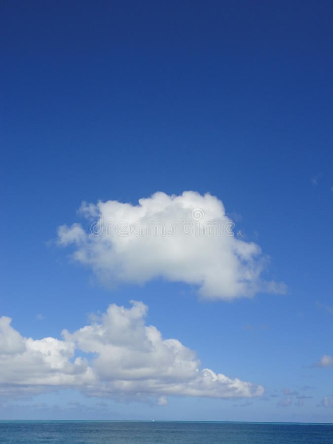 Облака над морем, Гаваи стоковое фото