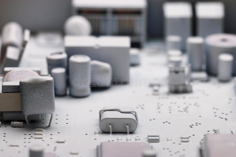 Обломоки предпосылки микроэлектроники белые стоковые фото