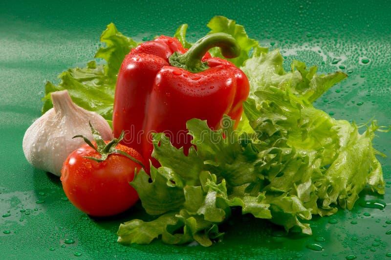 Овощи - томат, красный болгарский перец, паприка, чеснок стоковая фотография