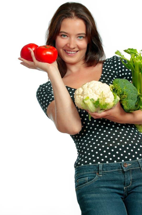 Овощи удерживания женщины Smilng стоковая фотография