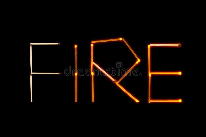 ` Огня ` слова, положенное вне с спичками стоковые изображения