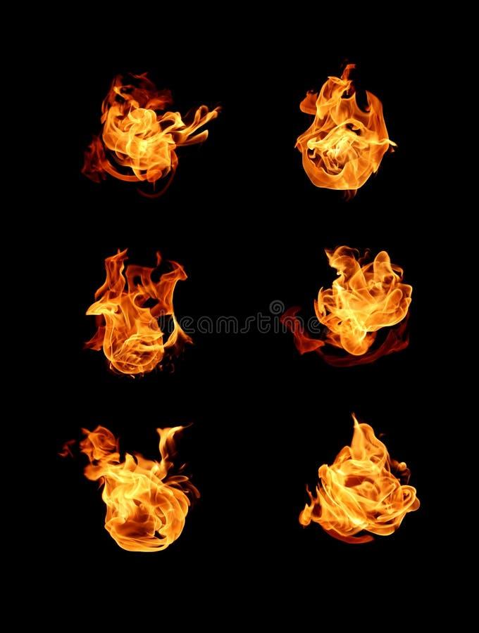 Огонь пылает собрание изолированное на черной предпосылке стоковое фото