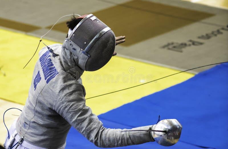 Ограждать чемпионат мира конкурента IBRAGIMOV Kamil стоковые фотографии rf