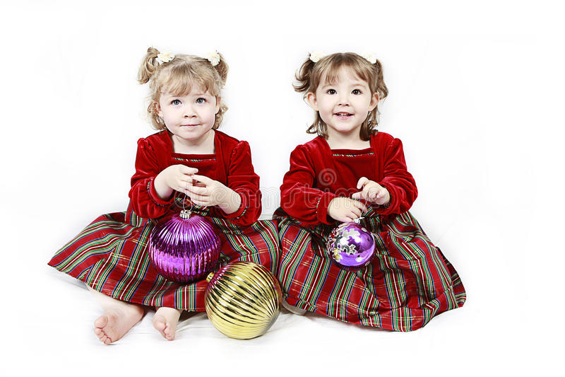 одевает красный цвет 2 девушок стоковые изображения rf