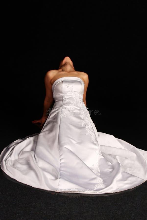 одетьйте ее колени wedding женщина стоковые фото