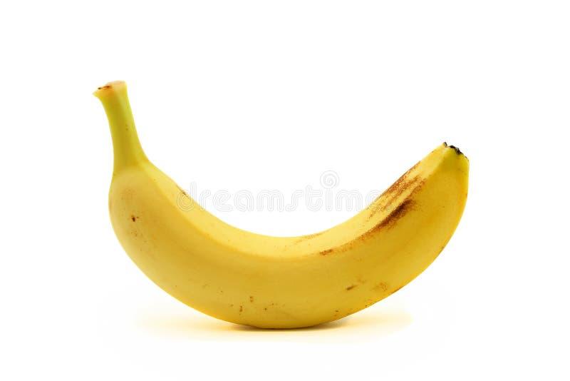 Одиночный банан на белой предпосылке стоковое изображение
