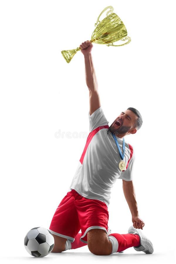 Один профессиональный футболист празднует победу торжество счастливое Футболист держит руку трофея одного Изолированный дальше стоковое фото