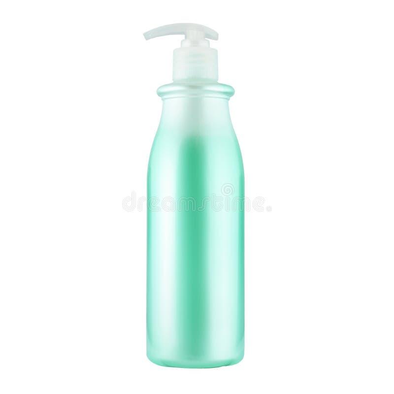 Одна косметическая бутылка с зеленой жидкостью стоковые изображения