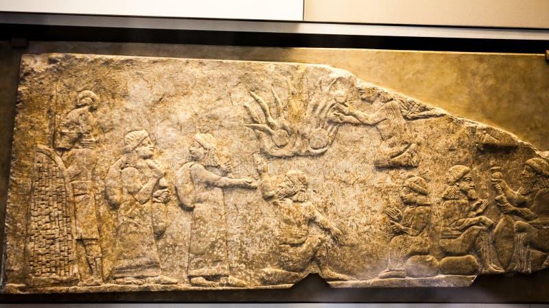 29-ое июля 2015 ЛОНДОН, Великобритания, ВЕЛИКОБРИТАНСКИЙ МУЗЕЙ - сброс показывая вавилонских пленников стоковые фото