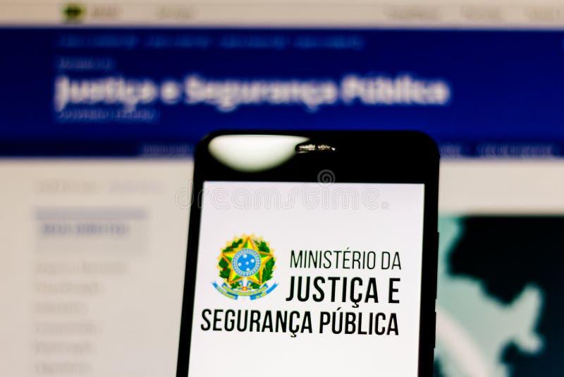 10-ое марта 2019, Бразилия Логотип министерства правосудия и общественной безопасности Бразилии на экране мобильного устройства О стоковое фото