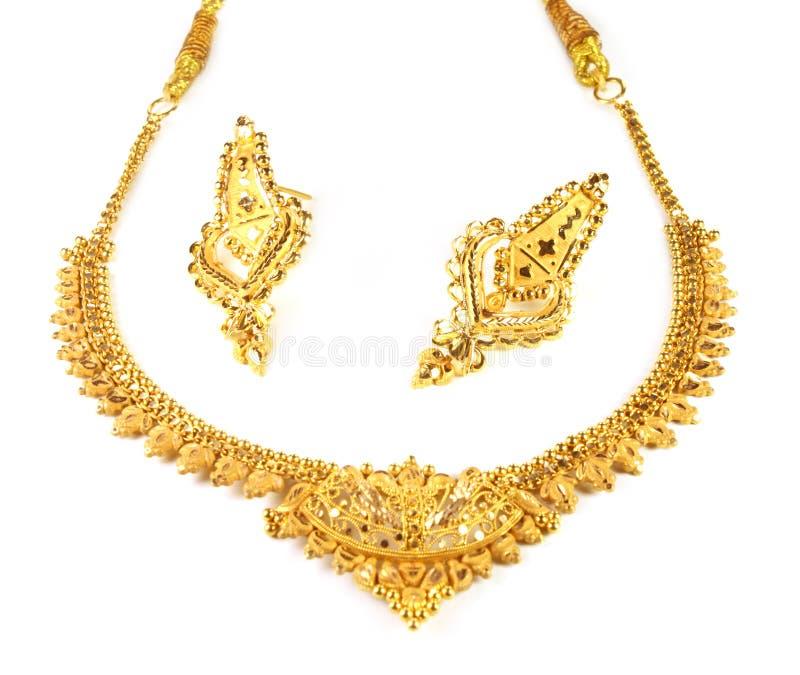 Ожерелье золота венчания с серьгами стоковые изображения rf