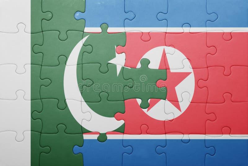 Озадачьте с национальным флагом Северной Кореи и Пакистана стоковая фотография rf