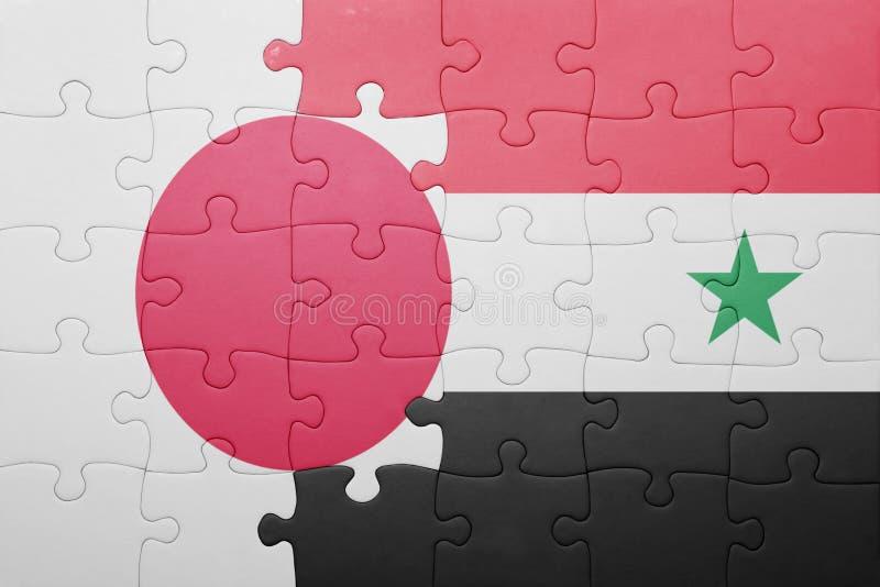 Озадачьте с национальным флагом Сирии и Японии стоковое изображение rf