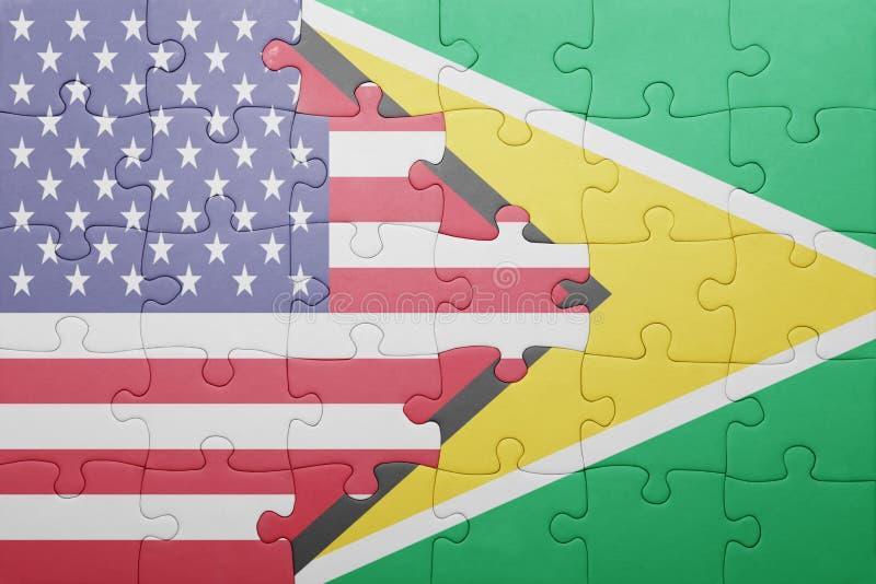 Озадачьте с национальным флагом Соединенных Штатов Америки и Гайаны стоковое фото rf