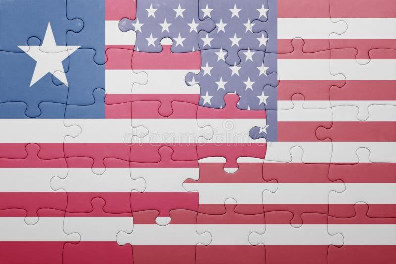 Озадачьте с национальным флагом Соединенных Штатов Америки и Либерии стоковая фотография rf