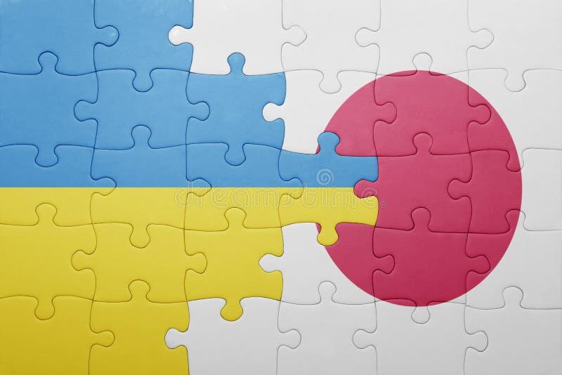 Озадачьте с национальным флагом Украины и Японии стоковые изображения