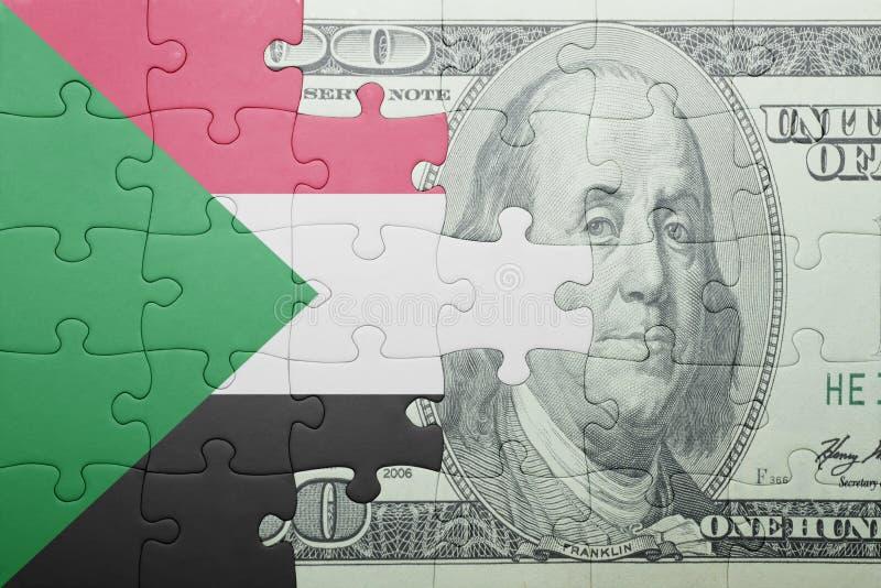 Озадачьте с национальным флагом банкноты Судана и доллара стоковое фото rf