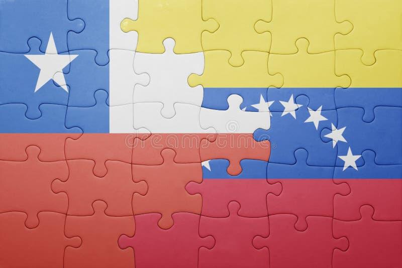 Озадачьте с национальным флагом Венесуэлы и chile стоковая фотография