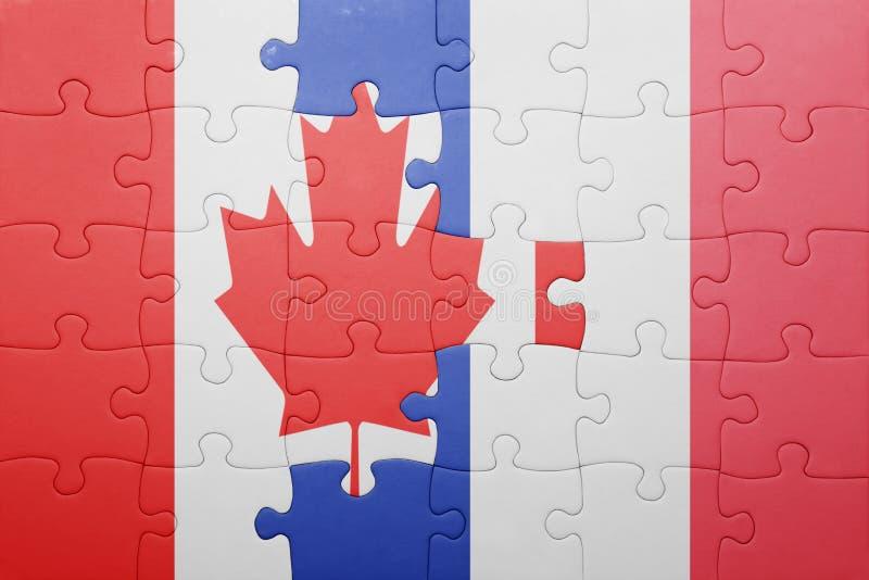 Озадачьте с национальным флагом Канады и Франции стоковое фото rf