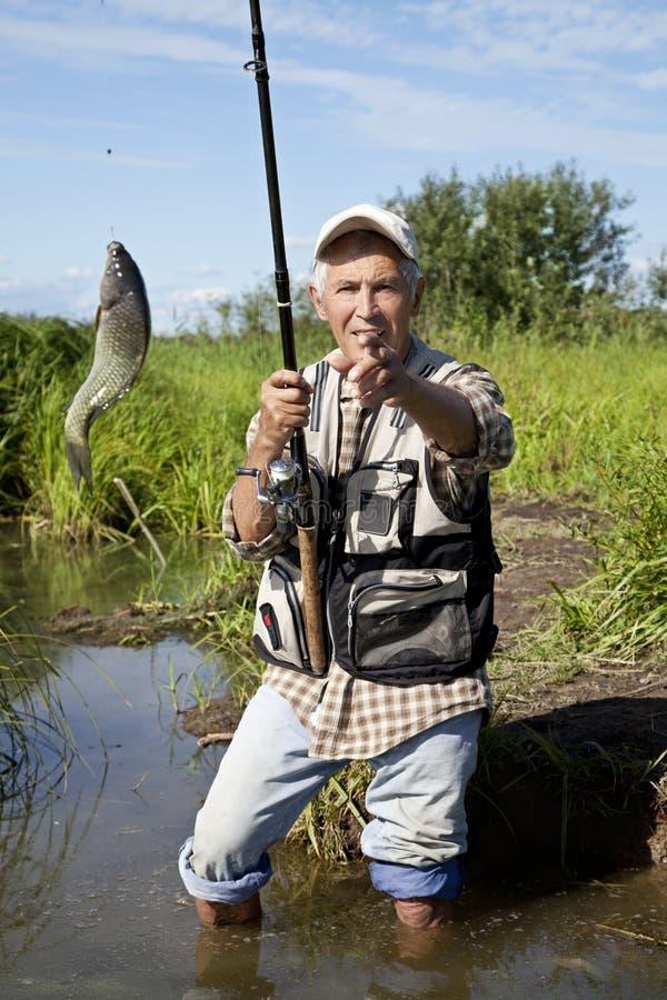 озеро мухы рыболовства рыболова стоковое фото