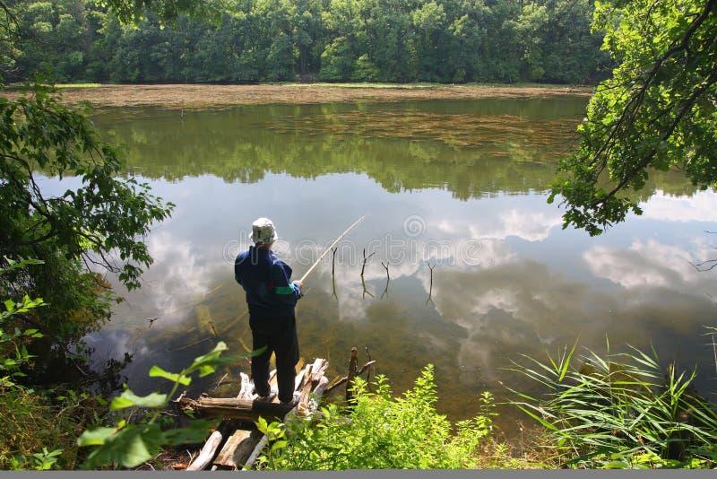 озеро рыболова стоковое фото rf