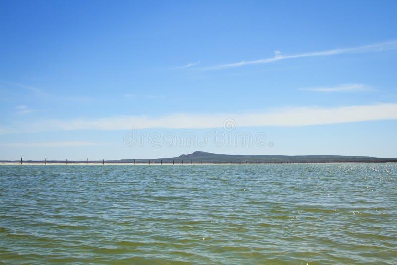 Download Озеро сол Baskunchak, Россия Стоковое Изображение - изображение насчитывающей bluets, гора: 33730099
