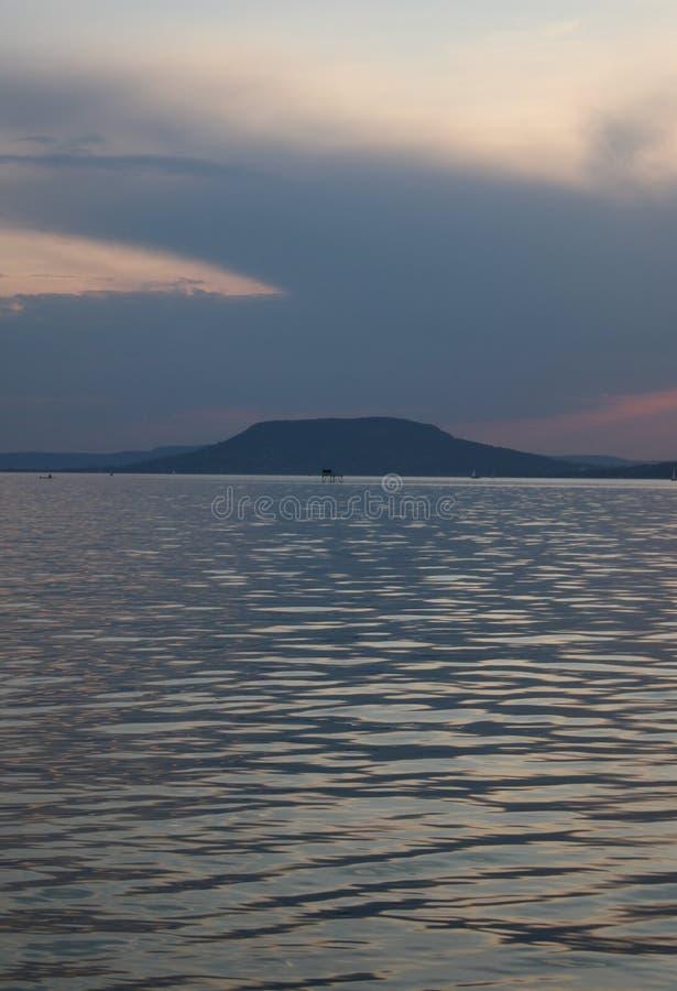 Озеро Balaton с заходом солнца стоковые изображения