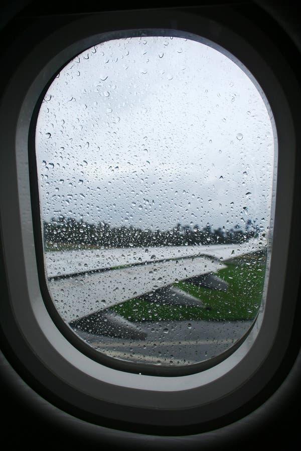 окно дождя аэроплана стоковые фотографии rf