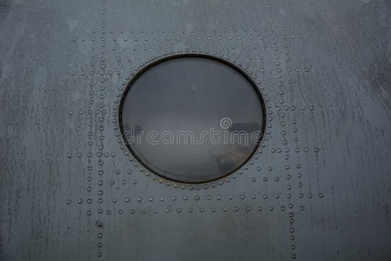 Окно самолета Grunge стоковое изображение