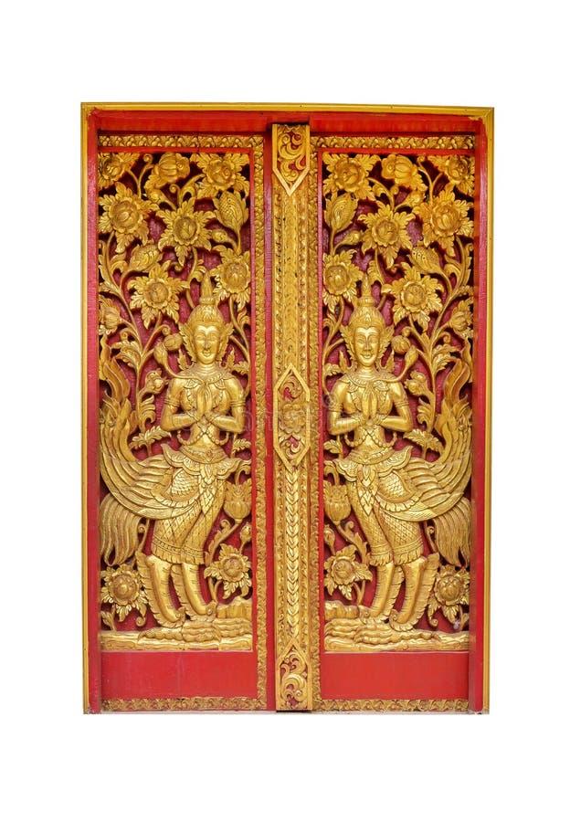 Окно тайского золота виска историческое на виске на белой предпосылке Красивое тайское окно виска изолировало стоковые фото