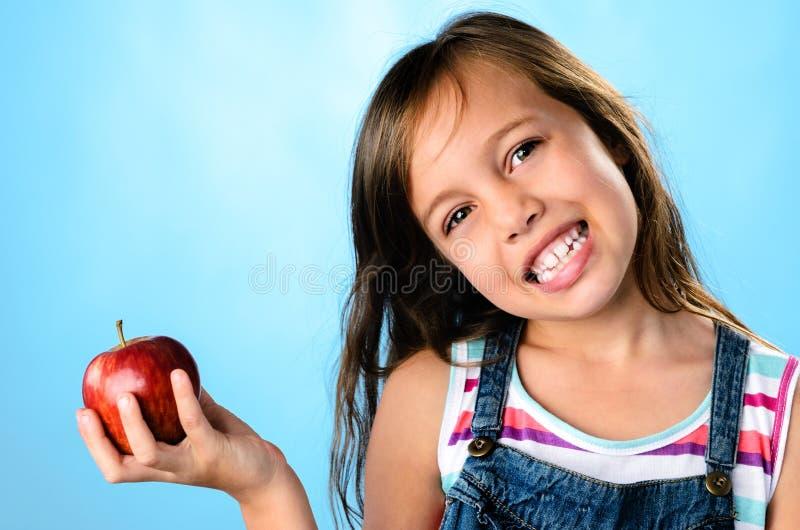 доктор дня яблока отсутствующий держит стоковое фото