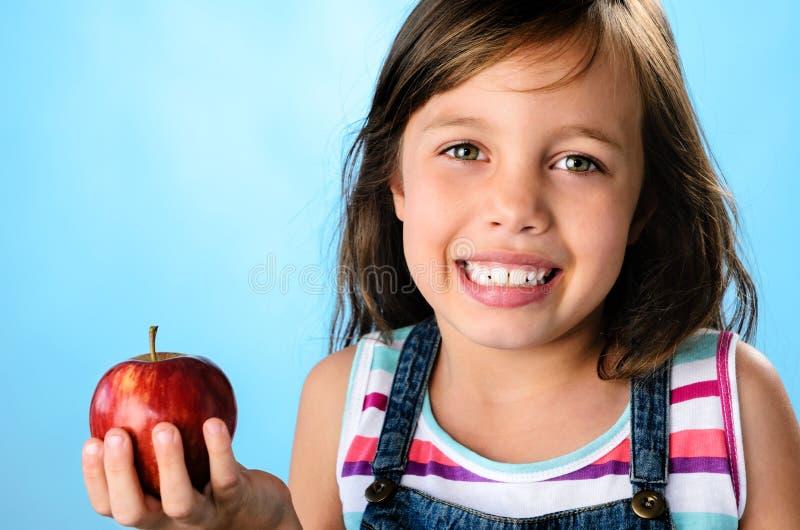 доктор дня яблока отсутствующий держит стоковая фотография