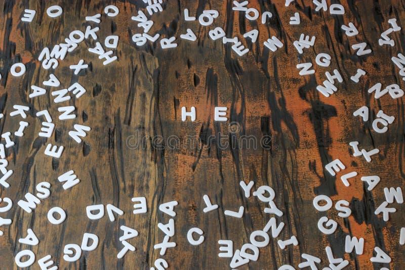 Он сказал по буквам в белых письмах стоковые изображения rf