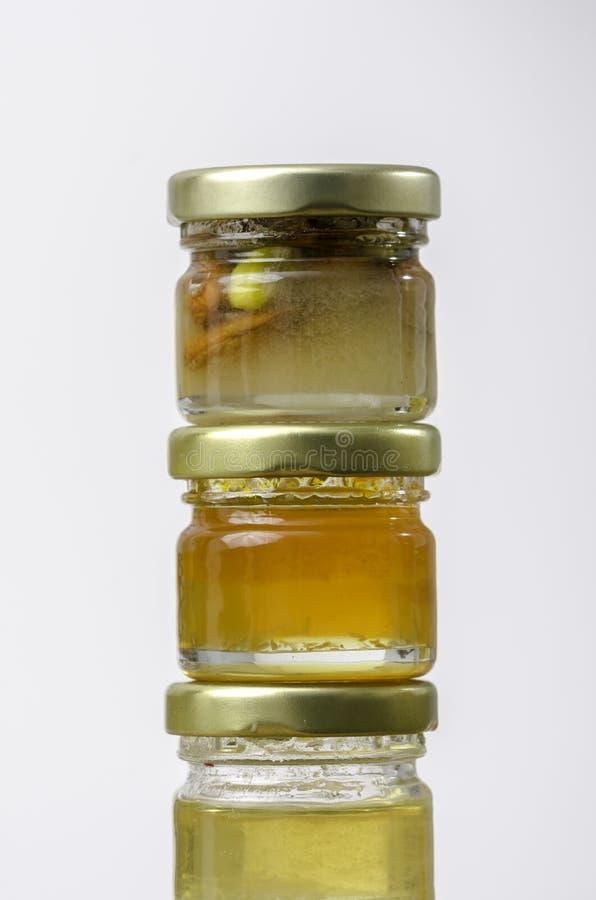 3 опарника меда вкусов differents стоковое изображение rf